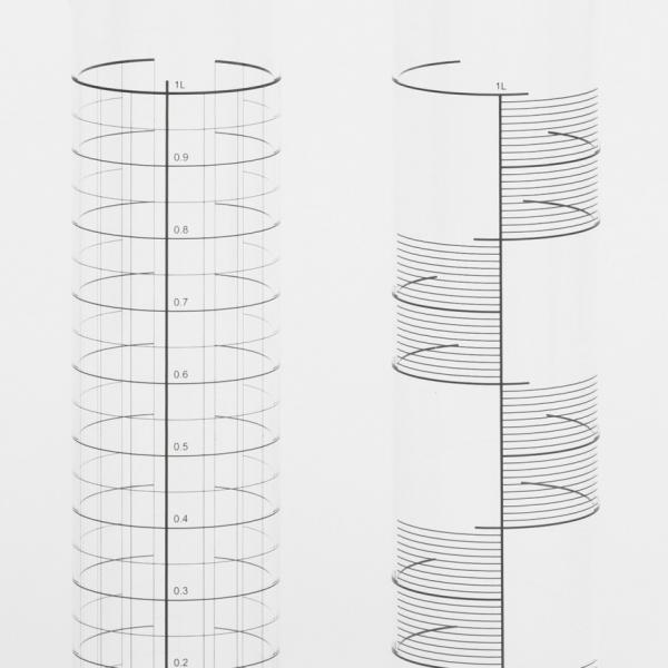 Set of four tall clear drinking glasses decorated with black measuring stripes that resemble those that might be found on laboratory glassware.