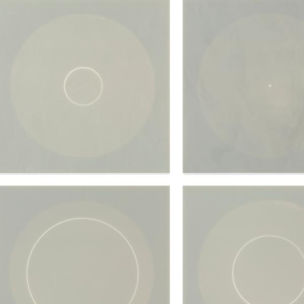 Six glass panels, each showing a lighter gray circle on a slightly darder gray background. Each lighter circle contains an even lighter outline of a circle somewhere within it.